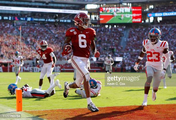 DeVonta Smith of the Alabama Crimson Tide takes this reception in for a touchdown against the Mississippi Rebels at Bryant-Denny Stadium on September...