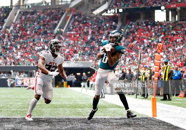 DeVonta Smith of the Philadelphia Eagles catches a 18-yard touchdown pass from Jalen Hurts against the Atlanta Falcons during the first quarter at...