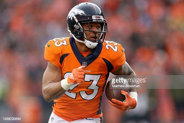 Devontae Booker of the Denver Broncos carries the ball for a touchdown against the Houston Texans at Broncos Stadium at Mile High on November 4, 2018...
