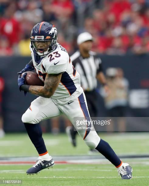 Devontae Booker of the Denver Broncos carries the ball in the second quarter against the Houston Texans at NRG Stadium on December 08, 2019 in...