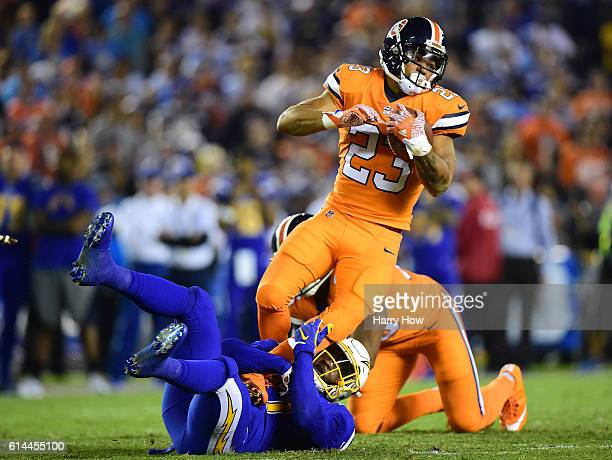 Devontae Booker of the Denver Broncos is tackled by Jatavis Brown of the San Diego Chargers during the third quarter of a 2113 Chargers win at...
