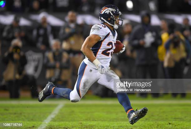 Devontae Booker of the Denver Broncos returns a kickoff against the Oakland Raiders during the first half of an NFL football game at the...