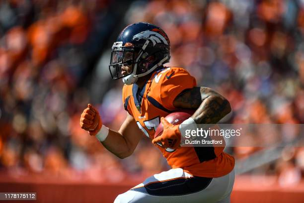 Devontae Booker of the Denver Broncos returns a kickoff against the Jacksonville Jaguars in the first quarter of a game at Empower Field at Mile High...