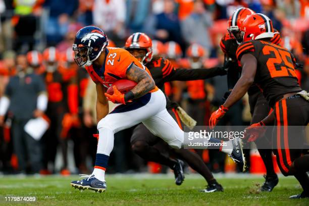 Devontae Booker of the Denver Broncos runs for a 32-yard kickoff return during the second quarter against the Cleveland Browns at Empower Field at...