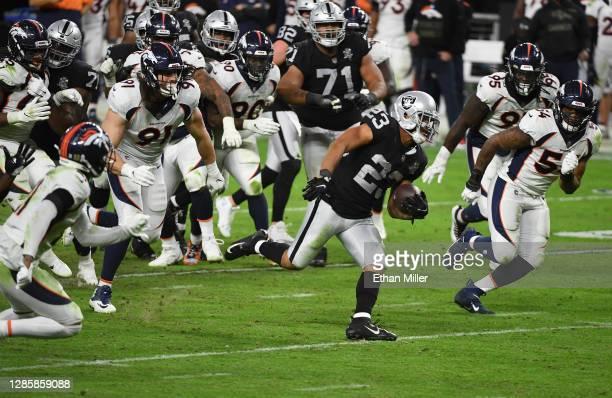 Devontae Booker of the Las Vegas Raiders runs for a touchdown against the Denver Broncos during the second half at Allegiant Stadium on November 15,...