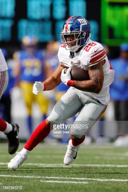 Devontae Booker of the New York Giants carries the ball during the first half against the Los Angeles Rams at MetLife Stadium on October 17, 2021 in...