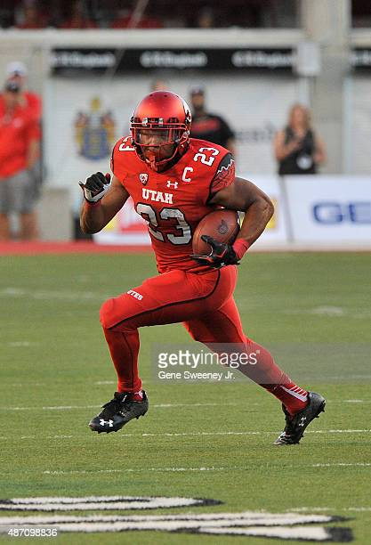 Devontae Booker of the Utah Utes runs with the ball during their game against the Michigan Wolverines at Rice-Eccles Stadium on September 3, 2015 in...