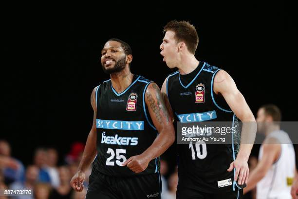 Devonte DJ Newbill and Tom Abercrombie of the Breakers celebrate a basket late in the game during the round nine NBL match between the New Zealand...