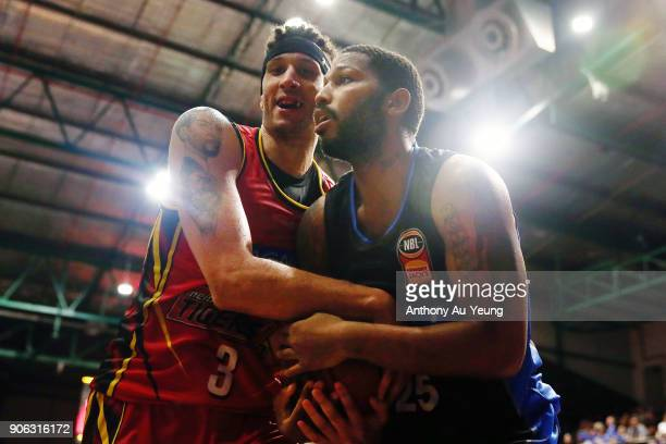 Devonte DJ Newbill of the Breakers competes for the ball against Josh Boone of United during the round 16 NBL match between the New Zealand Breakers...