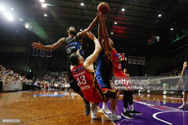 Devonte DJ Newbill of the Breakers competes for the rebound against Chris Goulding of United during the round 16 NBL match between the New Zealand...