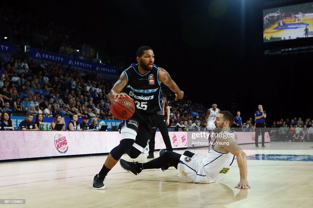 Devonte DJ Newbill of the Breakers drops Adam Gibson of the Bullets with a dribble move during the round nine NBL match between the New Zealand Breakers and the Brisbane Bullets at Spark Arena on December 7, 2017 in Auckland, New Zealand.