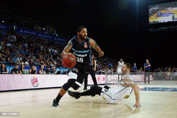 Devonte DJ Newbill of the Breakers drops Adam Gibson of the Bullets with a dribble move during the round nine NBL match between the New Zealand...
