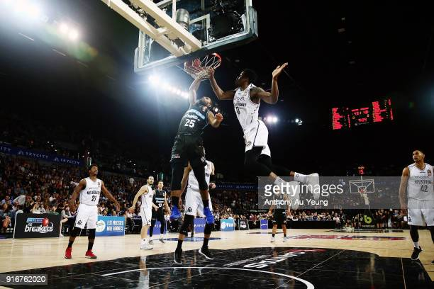 Devonte DJ Newbill of the Breakers dunks on Carrick Felix of United during the round 18 NBL match between the New Zealand Breakers and Melbourne...