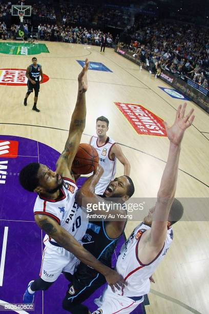 Devonte DJ Newbill of the Breakers is fouled by Ramone Moore of the 36ers during the round 10 NBL match between the New Zealand Breakers and the...