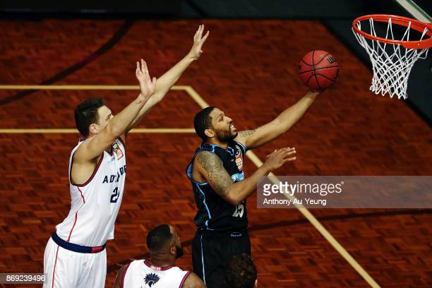 Devonte DJ Newbill of the Breakers scores on a layup during the round five NBL match between the New Zealand Breakers and the Adelaide 36ers at North...
