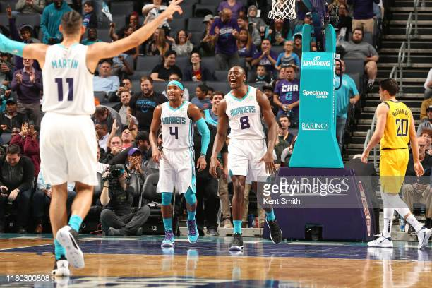 Devonte' Graham and Bismack Biyombo of the Charlotte Hornets celebrate during a game against the Indiana Pacers on November 5 2019 at Spectrum Center...