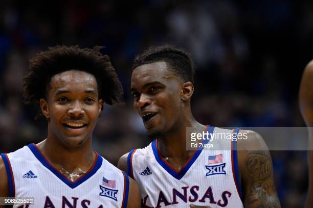 Devonte' Graham and Lagerald Vick of the Kansas Jayhawks talks during a time out against Iowa State Cyclones at Allen Fieldhouse on January 9 2018 in...
