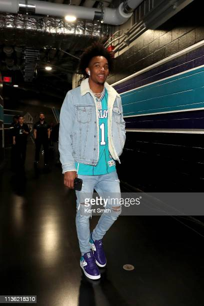 Devonte' Graham of the Charlotte Hornets arrives to the arena before the game against the Orlando Magic on April 10 2019 at Spectrum Center in...