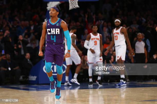 Devonte' Graham of the Charlotte Hornets celebrates after hitting a three point basket with 2 seconds left in the fourth quarter to win the game...