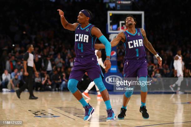 Devonte' Graham of the Charlotte Hornets celebrates with Malik Monk after hitting a three point basket with 2 seconds left in the fourth quarter to...