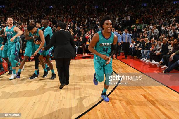 Devonte' Graham of the Charlotte Hornets celebrates with teammates after winning the game against the Toronto Raptors on March 24 2019 at the...
