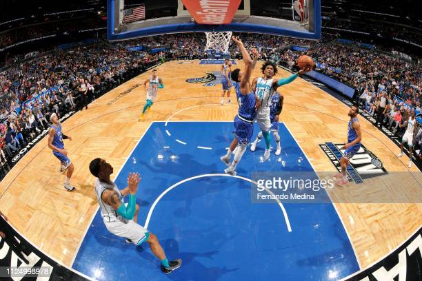 Devonte' Graham of the Charlotte Hornets goes to the basket against the Orlando Magic on February 14 2019 at Amway Center in Orlando Florida NOTE TO...