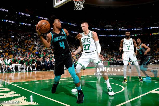 6818fc1c6 Devonte  Graham of the Charlotte Hornets handles the ball against the Boston  Celtics on January