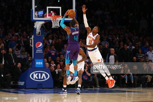 Devonte' Graham of the Charlotte Hornets hits a three point basket with 2 seconds left in the fourth quarter to win the game against the New York...