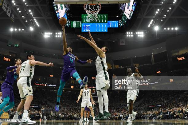 Devonte' Graham of the Charlotte Hornets shoots a lay up against Nikola Mirotic of the Milwaukee Bucks at Fiserv Forum on March 09 2019 in Milwaukee...