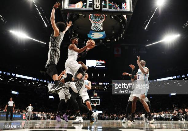 Devonte' Graham of the Charlotte Hornets takes a shot past Jarrett Allen of the Brooklyn Nets during the second half of their game at Barclays Center...