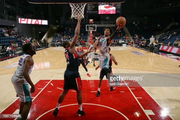 Devonte' Graham of the Greensboro Swarm goes up for a shot against Lavoy Allen of the Capital City GoGo during an NBA GLeague game at the...