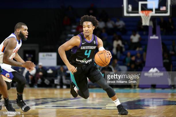 Devonte' Graham of the Greensboro Swarm handles the ball against the Westchester Knicks during the NBA GLeague on December 1 2018 at the Greensboro...