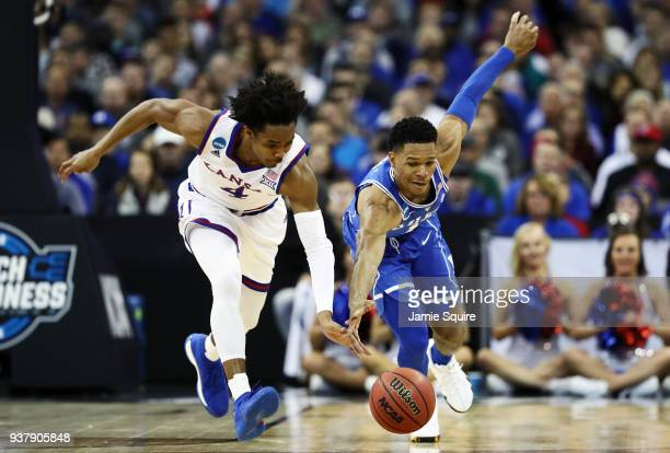 Devonte' Graham of the Kansas Jayhawks and Trevon Duval of the Duke Blue Devils battle for the ball during the first half in the 2018 NCAA Men's...