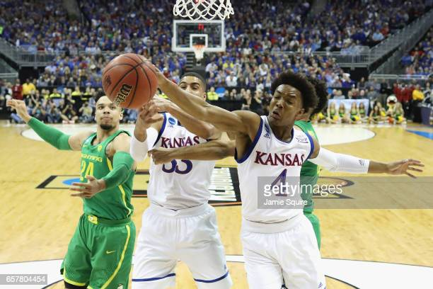 Devonte' Graham of the Kansas Jayhawks battles for a rebound in the first half against the Oregon Ducks during the 2017 NCAA Men's Basketball...