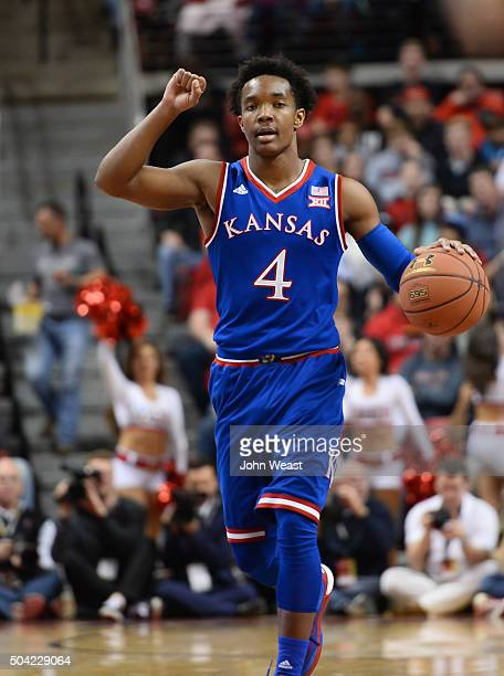 Devonte' Graham of the Kansas Jayhawks brings the ball up court during the game against the Texas Tech Red Raiders on January 09 2016 at United...
