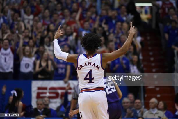 Devonte' Graham of the Kansas Jayhawks celebrates a basket against the TCU Horned Frogs at Allen Fieldhouse on February 6 2018 in Lawrence Kansas