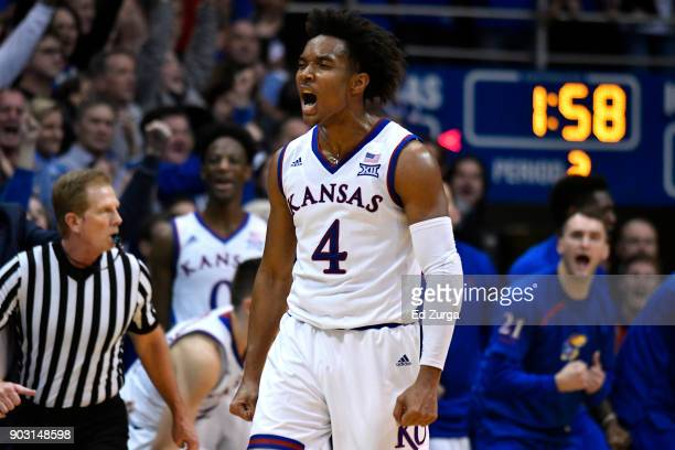 Devonte' Graham of the Kansas Jayhawks celebrates a shot against the Iowa State Cyclones in the second half at Allen Fieldhouse on January 9 2018 in...