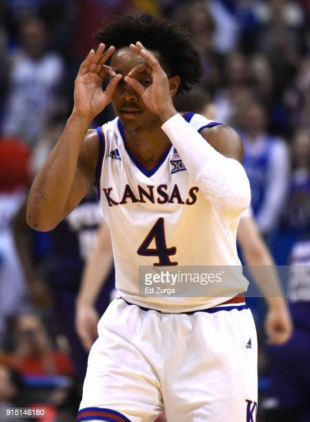 Devonte' Graham of the Kansas Jayhawks celebrates a shot against the TCU Horned Frogs in the second half at Allen Fieldhouse on February 6 2018 in...