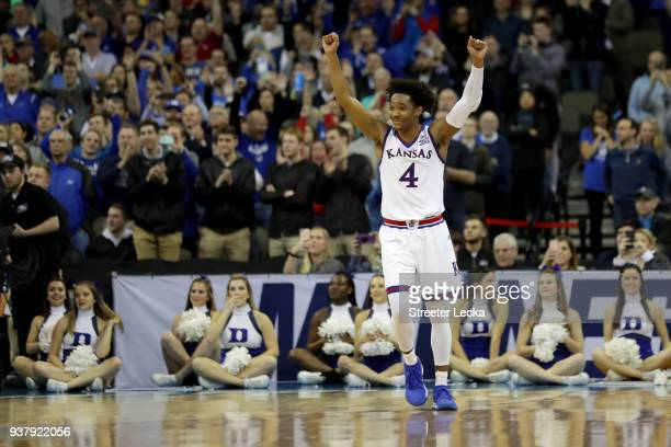 Devonte' Graham of the Kansas Jayhawks celebrates after defeating the Duke Blue Devils with a score of 81 to 85 in the 2018 NCAA Men's Basketball...