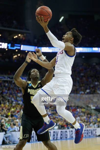 Devonte' Graham of the Kansas Jayhawks drives to the basket against Caleb Swanigan of the Purdue Boilermakers in the first half during the 2017 NCAA...