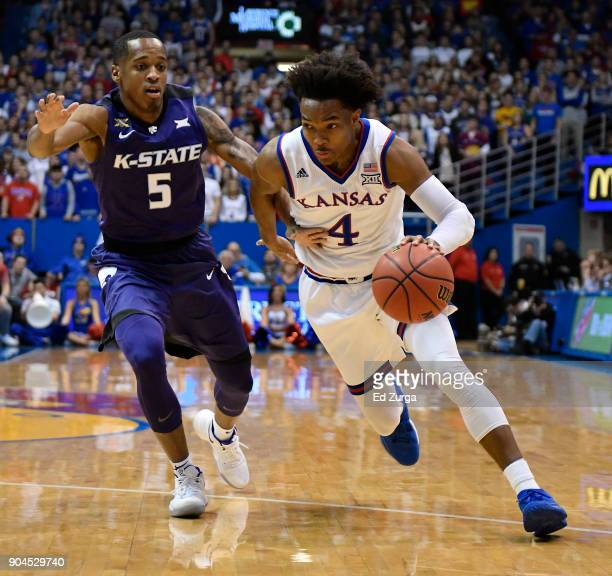 Devonte' Graham of the Kansas Jayhawks drives to the goal against Barry Brown Jr #5 of the Kansas State Wildcats in the first half at Allen...