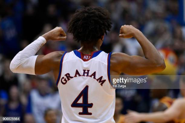 Devonte' Graham of the Kansas Jayhawks flexes his muscles during a game against the Iowa State Cyclones at Allen Fieldhouse on January 9 2018 in...