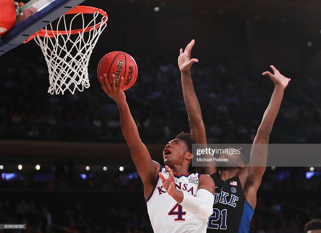 Devonte' Graham #4 of the Kansas Jayhawks puts up a layup over Amile Jefferson #21 of the Duke Blue Devils in the second half during the State Farm Champions Classic at Madison Square Garden on November 15, 2016 in New York City.