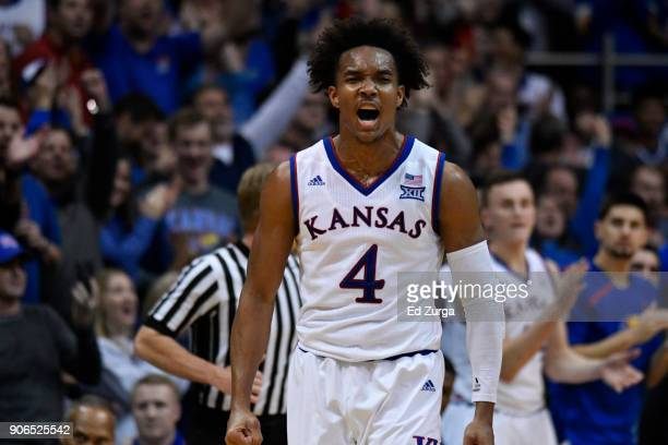 Devonte' Graham of the Kansas Jayhawks reacts after making a shot against Iowa State Cyclones at Allen Fieldhouse on January 9 2018 in Lawrence Kansas