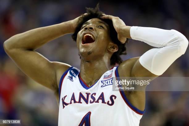 Devonte' Graham of the Kansas Jayhawks reacts against the Duke Blue Devils during the second half in the 2018 NCAA Men's Basketball Tournament...