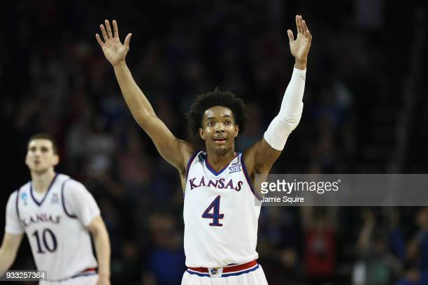 Devonte' Graham of the Kansas Jayhawks reacts against the Seton Hall Pirates in the second half during the second round of the 2018 NCAA Men's...