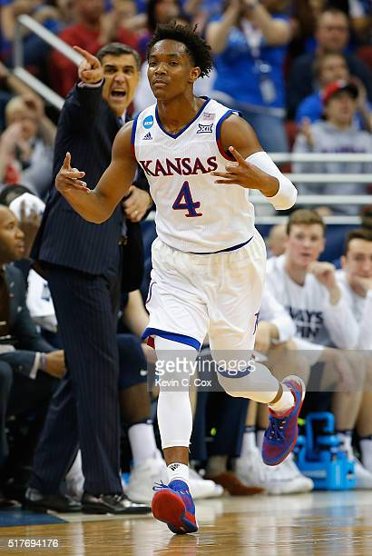 Devonte' Graham of the Kansas Jayhawks reacts in the first half against the Villanova Wildcats during the 2016 NCAA Men's Basketball Tournament South...