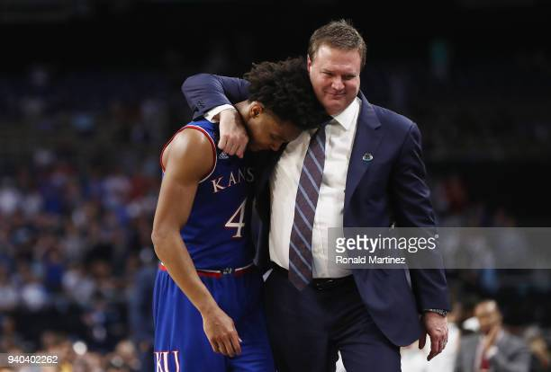 Devonte' Graham of the Kansas Jayhawks reacts with head coach Bill Self late in the second half against the Villanova Wildcats during the 2018 NCAA...