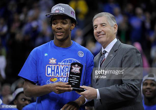 Devonte' Graham of the Kansas Jayhawks receives the MVP of the Big 12 Basketball Tournament from commissioner Bob Bowlsby at Sprint Center on March...