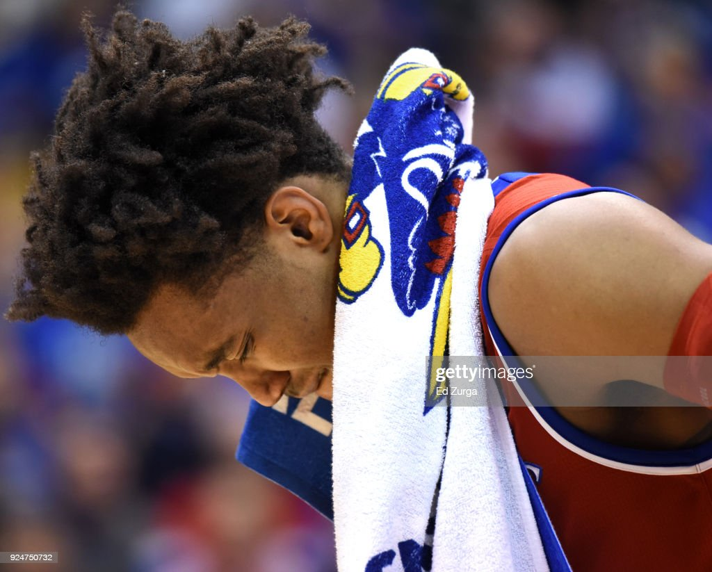 Devonte' Graham #4 of the Kansas Jayhawks sheds a tear as he says farewell to fans after playing his final game at Allen Fieldhouse on February 26, 2018 in Lawrence, Kansas. Kansas beat the Texas Longhorns 80-70.